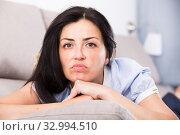 Купить «Young sad woman lying on cozy sofa», фото № 32994510, снято 2 июня 2017 г. (c) Яков Филимонов / Фотобанк Лори