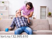 Купить «Young student and his old grandpa at home», фото № 32995610, снято 30 июля 2019 г. (c) Elnur / Фотобанк Лори