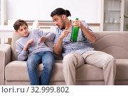 Купить «Drunk father and his son», фото № 32999802, снято 21 мая 2019 г. (c) Elnur / Фотобанк Лори