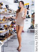 Купить «Woman holding desired shoe», фото № 33000186, снято 19 февраля 2020 г. (c) Яков Филимонов / Фотобанк Лори