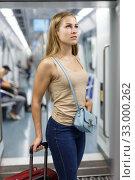 Купить «Woman traveling by subway train», фото № 33000262, снято 19 сентября 2018 г. (c) Яков Филимонов / Фотобанк Лори