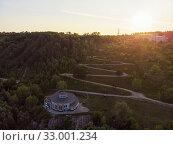 Купить «Aerial top vew of winding road in the city», фото № 33001234, снято 28 июля 2019 г. (c) Jan Jack Russo Media / Фотобанк Лори