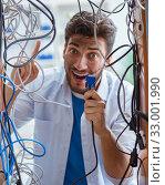 Купить «Electrician trying to untangle wires in repair concept», фото № 33001990, снято 7 июля 2017 г. (c) Elnur / Фотобанк Лори