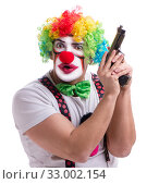 Купить «Funny clown with a gun pistol isolated on white background», фото № 33002154, снято 26 мая 2017 г. (c) Elnur / Фотобанк Лори