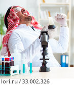 Купить «Arab chemist scientist testing quality of oil petrol», фото № 33002326, снято 21 апреля 2018 г. (c) Elnur / Фотобанк Лори