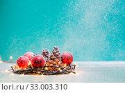 Купить «Christmas decorations with candles and pine corn», фото № 33003310, снято 6 июня 2020 г. (c) age Fotostock / Фотобанк Лори