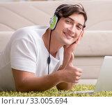 Купить «Freelancer working at home and listening to music», фото № 33005694, снято 25 октября 2016 г. (c) Elnur / Фотобанк Лори