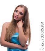 Купить «Beautiful young female model with make up posing isolated on whi», фото № 33005834, снято 14 июня 2017 г. (c) Elnur / Фотобанк Лори