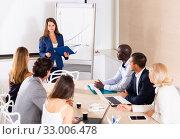 Купить «Young woman sharing business ideas with colleagues», фото № 33006478, снято 18 февраля 2020 г. (c) Яков Филимонов / Фотобанк Лори
