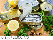 Tin can with smoked sprats, sardines, closeup. Стоковое фото, фотограф Яков Филимонов / Фотобанк Лори