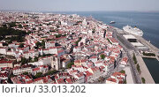 Купить «Aerial view of historical centre of Lisbon overlooking medieval Roman Catholic Cathedral and Castle of Sao Jorge, Portugal», видеоролик № 33013202, снято 20 апреля 2019 г. (c) Яков Филимонов / Фотобанк Лори