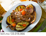 Купить «Slices of mutton with grilled eggplant», фото № 33018866, снято 26 февраля 2020 г. (c) Яков Филимонов / Фотобанк Лори
