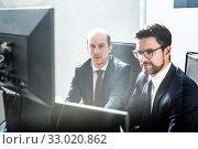 Купить «Business team analyzing data at business meeting in modern corporate office.», фото № 33020862, снято 10 января 2020 г. (c) Matej Kastelic / Фотобанк Лори