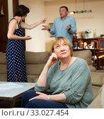 Купить «Upset elderly woman with arguing couple», фото № 33027454, снято 5 июня 2020 г. (c) Яков Филимонов / Фотобанк Лори