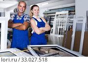 Workers standing in assembly shop of plastic windows. Стоковое фото, фотограф Яков Филимонов / Фотобанк Лори