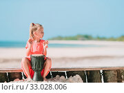 Little happy girl playing on african drums. Стоковое фото, фотограф Дмитрий Травников / Фотобанк Лори