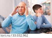 Father and teenage son after quarrel. Стоковое фото, фотограф Яков Филимонов / Фотобанк Лори