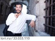 Smiling man flirting near grating window. Стоковое фото, фотограф Яков Филимонов / Фотобанк Лори
