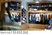 Купить «Variety of men clothes in modern shop», фото № 33033202, снято 15 февраля 2020 г. (c) Яков Филимонов / Фотобанк Лори