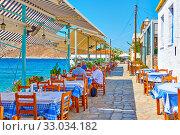 Купить «Seafood restaurant at waterfront by the sea in Perdika», фото № 33034182, снято 14 сентября 2019 г. (c) Роман Сигаев / Фотобанк Лори