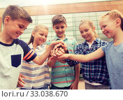 group of happy elementary school students. Стоковое фото, фотограф Syda Productions / Фотобанк Лори