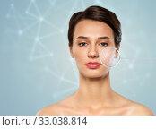 Купить «woman with low poly shape projection on face skin», фото № 33038814, снято 30 ноября 2019 г. (c) Syda Productions / Фотобанк Лори