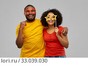 happy african american couple with party props. Стоковое фото, фотограф Syda Productions / Фотобанк Лори