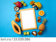 Купить «fruits around wooden frame with white background», фото № 33039086, снято 16 ноября 2018 г. (c) Syda Productions / Фотобанк Лори
