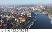 Купить «Aerial view of the Vltava river and the capital Prague. Czech Republic», видеоролик № 33045314, снято 14 октября 2019 г. (c) Яков Филимонов / Фотобанк Лори