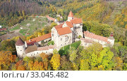 Купить «Above view of medieval castle Pernstein. South Moravian region. Czech Republic», видеоролик № 33045482, снято 15 октября 2019 г. (c) Яков Филимонов / Фотобанк Лори