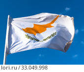Купить «Flag of the Republic of Cyprus against the blue sky», фото № 33049998, снято 6 октября 2019 г. (c) Володина Ольга / Фотобанк Лори
