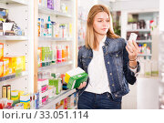 Купить «Female customer found medicines in pharmacy», фото № 33051114, снято 17 февраля 2020 г. (c) Яков Филимонов / Фотобанк Лори