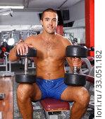 Guy with naked torso lifting dumbbells. Стоковое фото, фотограф Яков Филимонов / Фотобанк Лори