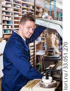 Working man practising skills with trimming machine. Стоковое фото, фотограф Яков Филимонов / Фотобанк Лори