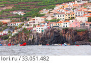 Купить «Fishing boats anchored near rocky coast. Madeira», фото № 33051482, снято 24 августа 2017 г. (c) EugeneSergeev / Фотобанк Лори