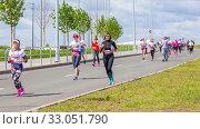Купить «Russia, Samara, May 2019: a group of young beautiful sports people run around the new stadium at a city event, race.», фото № 33051790, снято 19 мая 2019 г. (c) Акиньшин Владимир / Фотобанк Лори