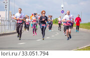Russia, Samara, May 2019: a group of young beautiful sports people run around the new stadium at a city event, race. Редакционное фото, фотограф Акиньшин Владимир / Фотобанк Лори