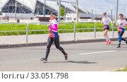Купить «Russia, Samara, May 2019: a group of young beautiful sports people run around the new stadium at a city event, race.», фото № 33051798, снято 19 мая 2019 г. (c) Акиньшин Владимир / Фотобанк Лори