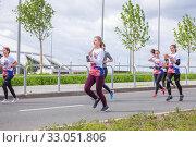 Купить «Russia, Samara, May 2019: a group of young beautiful sports people run around the new stadium at a city event, race.», фото № 33051806, снято 19 мая 2019 г. (c) Акиньшин Владимир / Фотобанк Лори