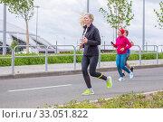 Купить «Russia, Samara, May 2019: a group of young beautiful sports people run around the new stadium at a city event, race.», фото № 33051822, снято 19 мая 2019 г. (c) Акиньшин Владимир / Фотобанк Лори