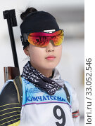Купить «Portrait of Korean sportswoman biathlete Lee Hyunju South Korea in shooting range. Regional junior biathlon competitions East of Cup», фото № 33052546, снято 13 апреля 2019 г. (c) А. А. Пирагис / Фотобанк Лори