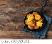 Купить «Potatoes pancakes or flapjacks on wooden table», фото № 33053362, снято 15 октября 2018 г. (c) Ольга Сергеева / Фотобанк Лори