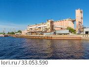 Купить «Industrial enterprise on the river bank in Kazan», фото № 33053590, снято 25 мая 2019 г. (c) Дмитрий Тищенко / Фотобанк Лори