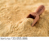 Купить «Nutritional yeast background. Nutritional inactive yeast with small wooden scoop. Copy space. Nutritional yeast is vegetarian superfood with cheese flavor, for healthy diet», фото № 33055886, снято 25 мая 2020 г. (c) easy Fotostock / Фотобанк Лори