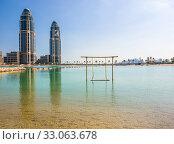 Doha, Qatar - Nov 11. 2019. New buildings skyscrapers on the Pearl Island. Редакционное фото, фотограф Володина Ольга / Фотобанк Лори