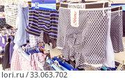 Купить «Russia Samara January 2020: Men's underwear hanging on hangers in the haberdashery department of the supermarket.», фото № 33063702, снято 11 января 2020 г. (c) Акиньшин Владимир / Фотобанк Лори