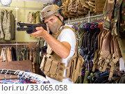 Купить «Male customer try on ammunition with rifle», фото № 33065058, снято 4 июля 2017 г. (c) Яков Филимонов / Фотобанк Лори