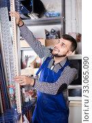 Male middle age labour working in PVC shop and smiling. Стоковое фото, фотограф Яков Филимонов / Фотобанк Лори