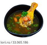 Купить «Delicious soup with chicken, bacon, leek and vegetables served in bowl», фото № 33065186, снято 29 февраля 2020 г. (c) Яков Филимонов / Фотобанк Лори