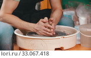Pottery - the master is pouring elongated clay with water and continuing modeling. Стоковое видео, видеограф Константин Шишкин / Фотобанк Лори